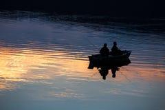 Small fishermen ship on a sundown lake Royalty Free Stock Photography