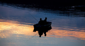 Small fishermen ship on a sundown lake Stock Photography