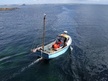 Small Fishing Boat. A small fishing boat leaving a Cornish harbour Stock Photography