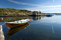 Small Fishing Boat. On calm clear water in Norway Royalty Free Stock Photo