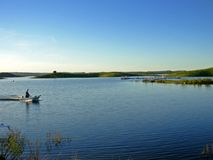 Small fishing boat. In the Guadiana river, Portugal stock images