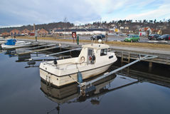 Small fishing boat. In plastic moored to the pier at the Tista river in Halden Royalty Free Stock Photos