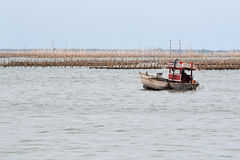 Small fishing boat. In sea Royalty Free Stock Photography