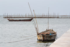 Small fishing boat. At pier Stock Photo