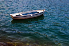 Small fishing boat. A small fishing boat floating on water Royalty Free Stock Image