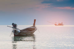 Small fishing boat abandon in ocean skyline Stock Photo