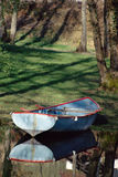 Small fishing boat in Aiguebelette, France stock photos
