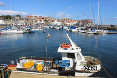 Small fishing boat in Anstruther harbour, Scotland. Small inshore fishing boat moored in Anstruther harbour, Fife, Scotland with yachts and other small boats in royalty free stock image