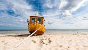 Fishing boat on the Baltic Sea beach Royalty Free Stock Photo
