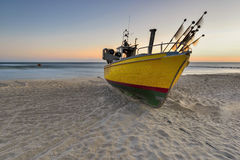 Small fishing boat, on the beach, of Baltic sea, Poland Stock Photo