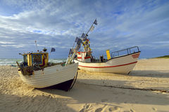 Small fishing boat, on the beach, of Baltic sea, Poland Royalty Free Stock Images