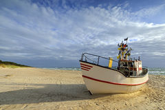 Small fishing boat, on the beach, of Baltic sea, Poland Royalty Free Stock Image