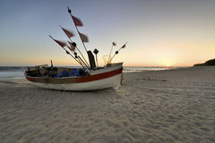 Small fishing boat, on the beach, of Baltic sea Stock Image