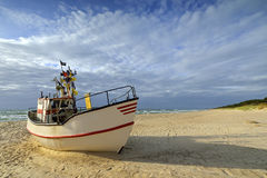 Small fishing boat, on the beach, of Baltic sea Stock Photography