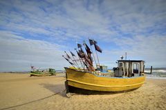 Small fishing boat, on the beach, of Baltic sea, Poland Royalty Free Stock Photography