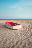 Small fishing boat on the beach and blue sky Stock Images