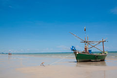 Small fishing boat on the beach Stock Images