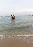 Small Fishing boat on the beach Stock Photo