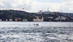 Small fishing boat on Bosphorus. Stock Photo