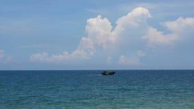 Small fishing boat crossing ocean stock video