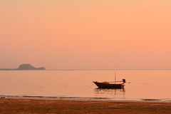 Small fishing boat at dawn. Small fishing boat and picturesque sea at dawn Royalty Free Stock Images