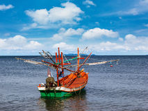 Small fishing boat on daylight Stock Photos