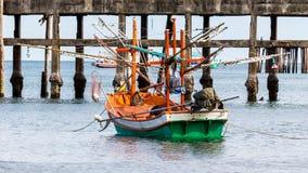 Small fishing boat at dock Stock Image