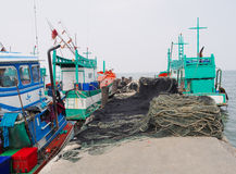 Small fishing boat with fishing net and equipment at fishing village Royalty Free Stock Images