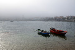 Small fishing boat and foggy day Stock Photography