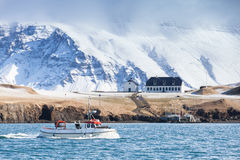 Small fishing boat goes in bay of Reykjavik Stock Image