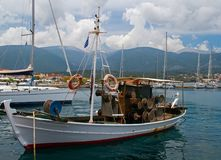 Small fishing boat in Greek harbour Stock Photos