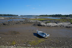 Small Fishing Boat grounded at low tide Royalty Free Stock Image