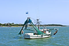 Small fishing boat heading out to the sea Stock Image