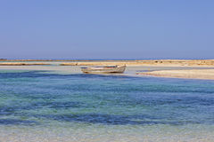 Small fishing boat at lagoon Balos Stock Photo