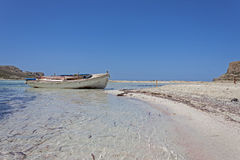 Small fishing boat at lagoon Balos Royalty Free Stock Photo