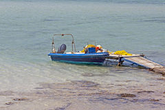 Small fishing boat at lagoon Balos Stock Photos