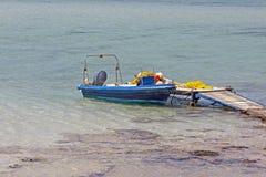 Small fishing boat at lagoon Balos stock photos