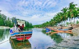 Small fishing boat at the lake shore Stock Photography