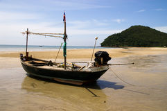 Small fishing boat landing beach Royalty Free Stock Photos