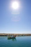 Small fishing boat leaving the port of Duquesa in Spain Royalty Free Stock Image