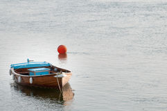Free Small Fishing Boat Moored In The Water Ready For Sailing Royalty Free Stock Photo - 74054595