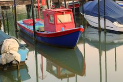Small fishing boat moored in the marina Stock Photography