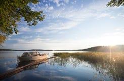 Small fishing boat moored on Saimaa lake. In Imatra town, Finland royalty free stock photos