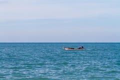 Small fishing boat in morning light Stock Image