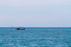 Small fishing boat in morning light Stock Photos