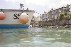 Close up of a small fishing boat in Mousehole Harbour stock photography