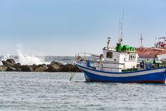 Small fishing boat at an ocean port of Santa Cruz town on Tenerife island, Spain. Stock Photography