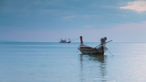 Small fishing boat in ocean skyline Royalty Free Stock Images