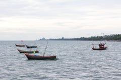 Small fishing boat on ocean Stock Photo