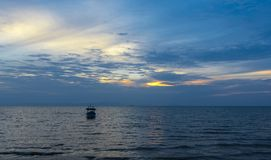 Fishing boat at sunset. Small fishing boat off the Cambodian coast at sunset Royalty Free Stock Photo